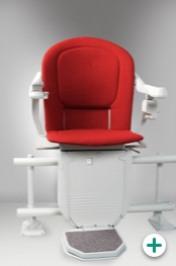 Foto des Sitzlift Modell 6100 für kurvige Treppen mit rotem Polster